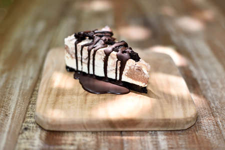 cookies and cream: Cream cake with cookies and chocolate syrup on top Stock Photo