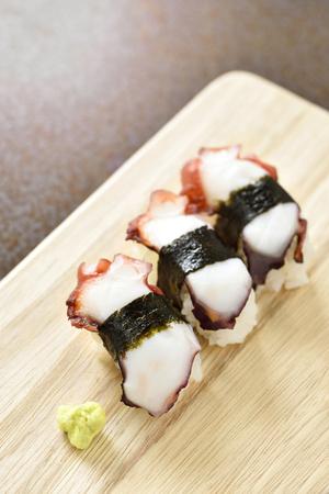 lunch tray: Tako sushi on wood tray