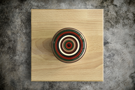 Green tea lacquer bowl on wood plate (Top View)