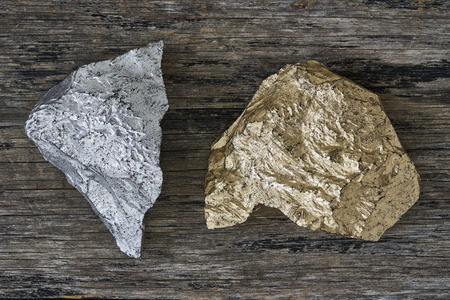 goldmine: Gold and Silver ore on wood plate