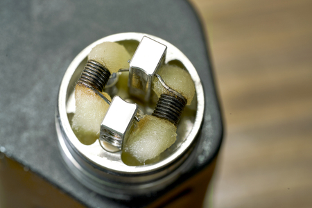 Fused Clapton Coil on Dripper for vape with cotton and liquid Stock Photo