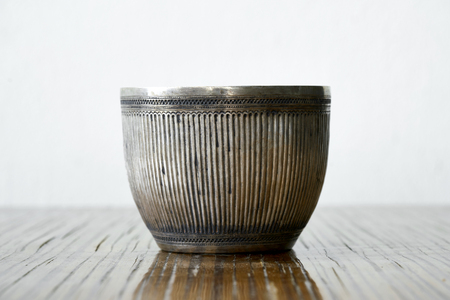 Antique silver bowl on wood table