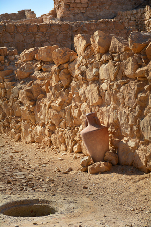 Ancient amphora near rocky wall in Masada fortress, Israel 版權商用圖片