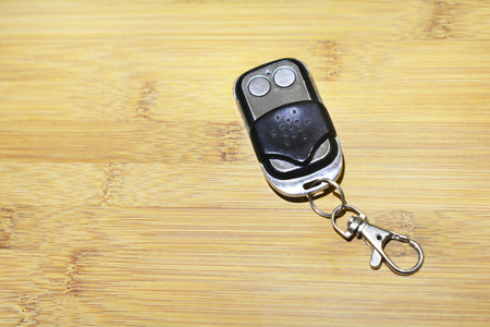Door or gate remote on wooden surface