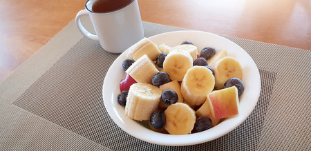 A bowl with fresh fruits - healthy nutrition concept