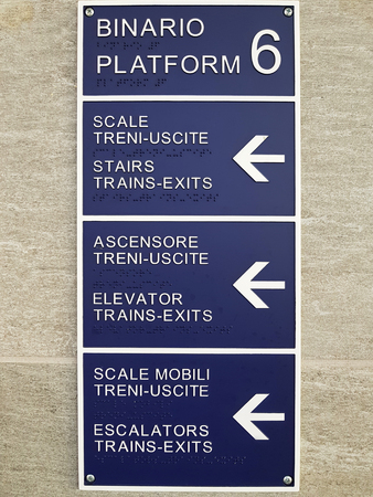 Train station platform information table with Braille text