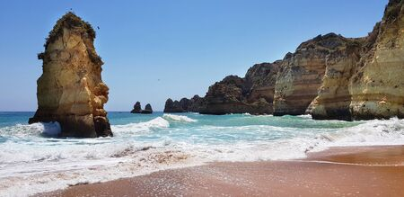Beautiful landscape: cliffs in turquoise Atlantic ocean near beach Praia Dona Ana, Lagos, Portugal