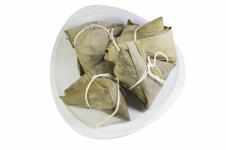zongzi in dish in isolated white background photo