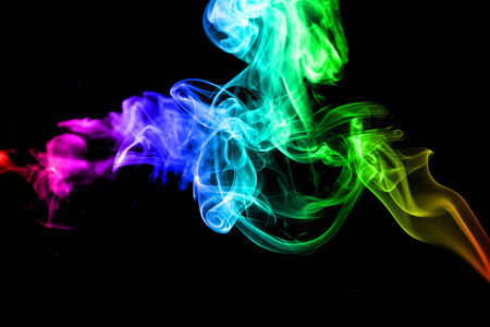 rainbow color of smoke in isolated black background photo