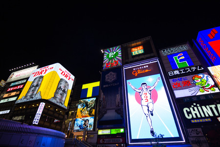 thronged: Dotonbori -  2014 October 27 : district in Osaka, Japan , is a large scale downtown along the south bank of the Dotonbori-gawa Canal. Osaka is known as the gastronomists town, and thus the entire area of Dotonbori is thronged with an unbelievable number