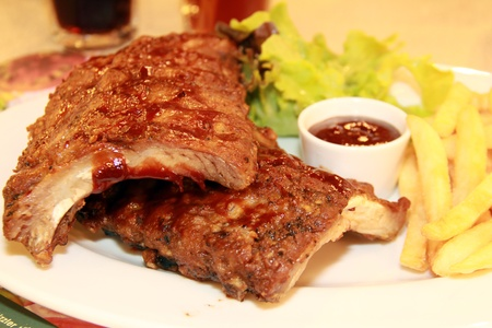 bbq spareribs with frenchfried photo