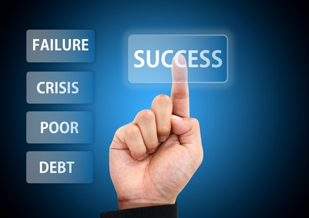 business hand press to success button Stock Photo - 11245477