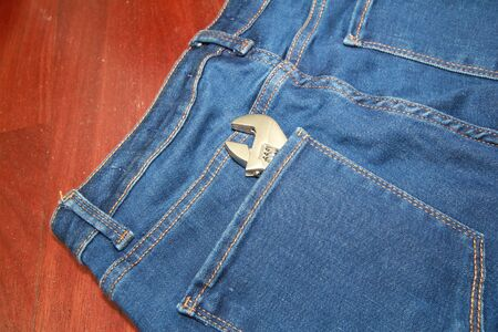 jean with a tool in a pocket photo