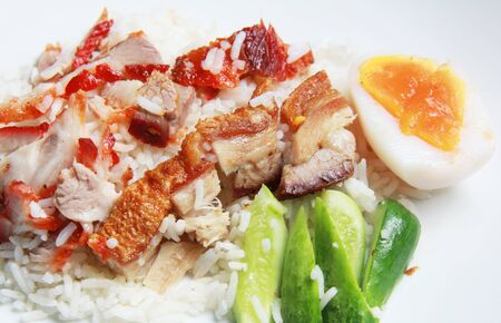 a rice with crispy and bbq pork photo