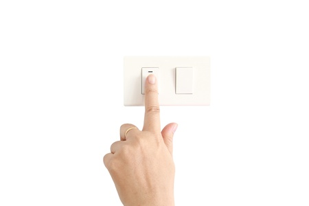 isolated hand push the light switch photo