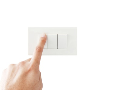 light switch: isolated hand close the light switch