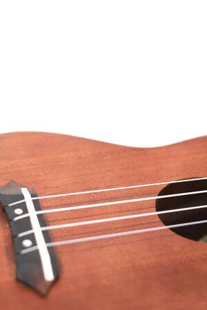 isolated part of wooden ukulele photo