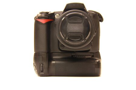 isolated DSLR camera with grip photo
