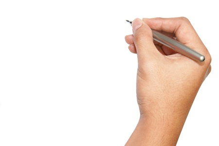 isolated hand using pen to write photo