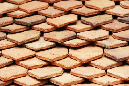 cedar shakes: old red brick roof texture