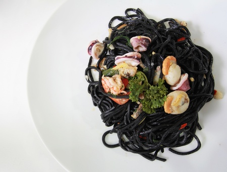 squid ink spaghetti with seafood photo