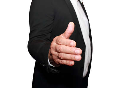 isolated businessman offering to shake your hand photo