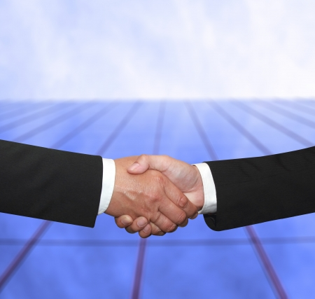 shake hand in front of a building for agreement photo