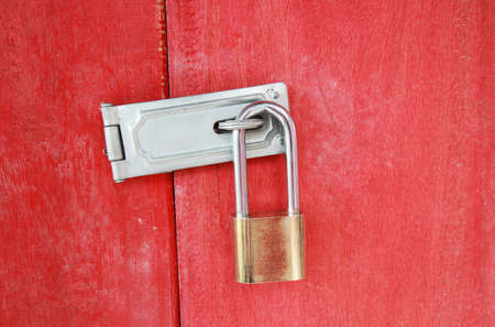 safety lock on a red wooden door photo