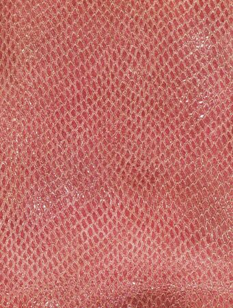 background of red snakeskin texture photo