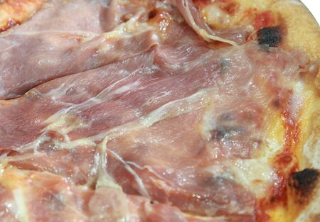 close up on parma ham pizza photo