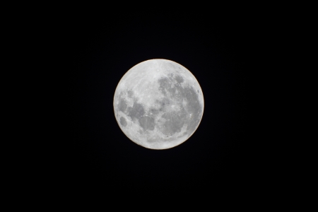 full moon shy in a clear sky photo