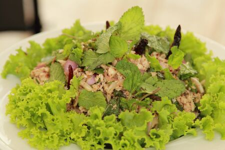 spicy minced pork salad in a plate photo