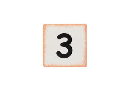 isolated wooden cubic with number three photo