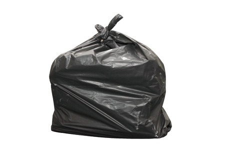 isolated full black garbage bag in white background photo