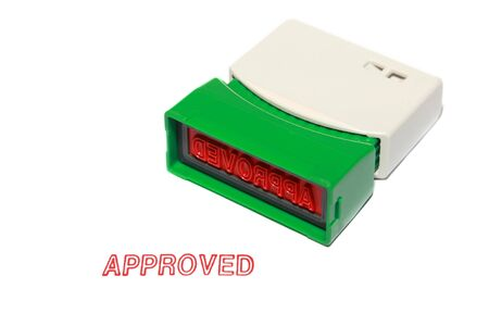 approved stamp press on white paper photo