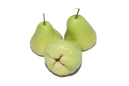 isolated three green rose apples in white background photo