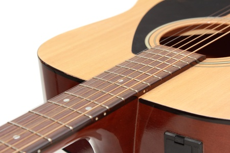 isolated part of wooden guitar photo
