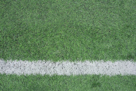 american football background: green soccer field with white stripe background