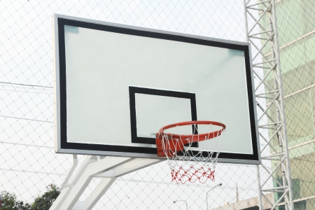 the height of a rim: basketball hoop in public sport center Stock Photo
