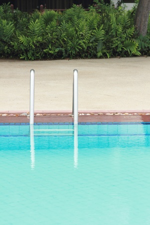 bars ladder in the swimming pool photo