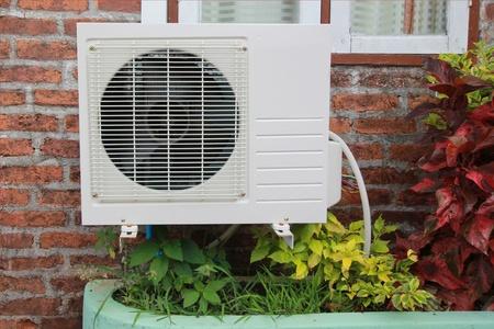 air compressor on the brick wall Standard-Bild