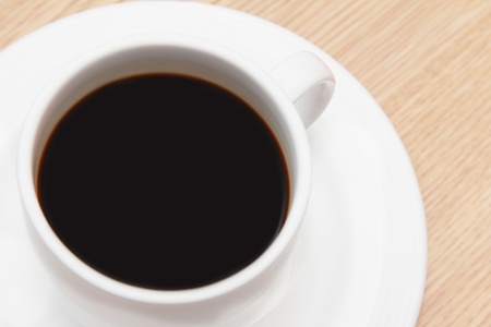 cup of espresso on wooden table photo