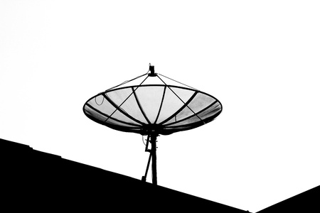 isolated silhouette satellite dish on the roof photo