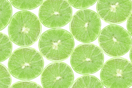 background of slice green lime in white background photo