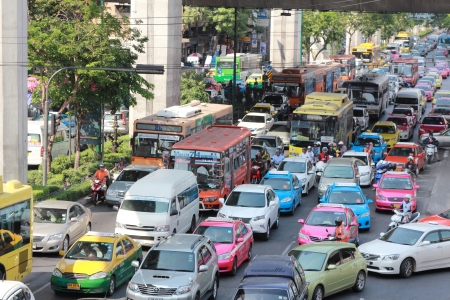 BANGKOK - MARCH 23: Traffic jam along a busy road near Victory Monument on March 23, 2013 in Bangkok, Thailand.After the new government first car polcy,traffic jam is more than before