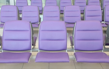 roll of purple chair at the airport photo