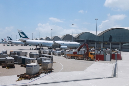 HONGKONG  JUNE 29 2013:Cathey Pacific plane ready for boarding in Hong Kong Airport on 29 June 2013. Cathey Pacific was  founded in 1946. This company bacome one of the famous airline in Hong Kong