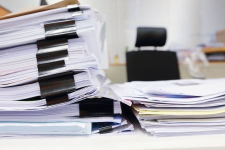 stack of documents: messy office table with business documents Stock Photo