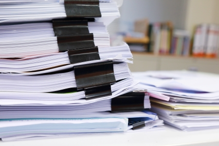 disarray: messy office table with business documents Stock Photo