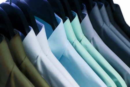 dry and clean: background of shirts hanging on a hanger